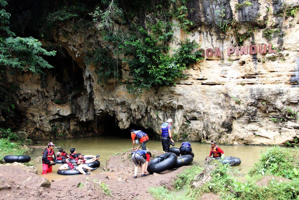 Cave Pindul: A mysterious adventure wading through water into the cave