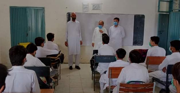 Civil society members visit schools to welcome students and teachers